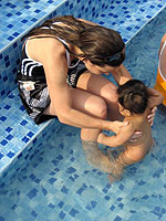 Orphaned baby having fun at the swimming pool