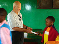 Distributin Bibles to orphans in Kenya