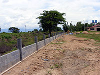 Fence being consturcted at children's village in Thailand