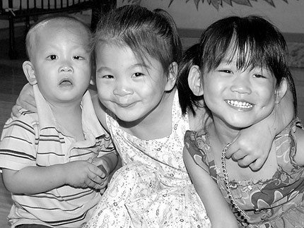 John Kay visits orphans at New Hope Foundation in China