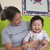 Sally with Ren Ai at New Hope Foundation